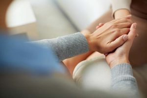 a patient being comforted during intensive outpatient rehab