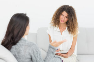 a woman talking to her doctor about women's rehab center